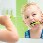 Letting kids brush on their own
